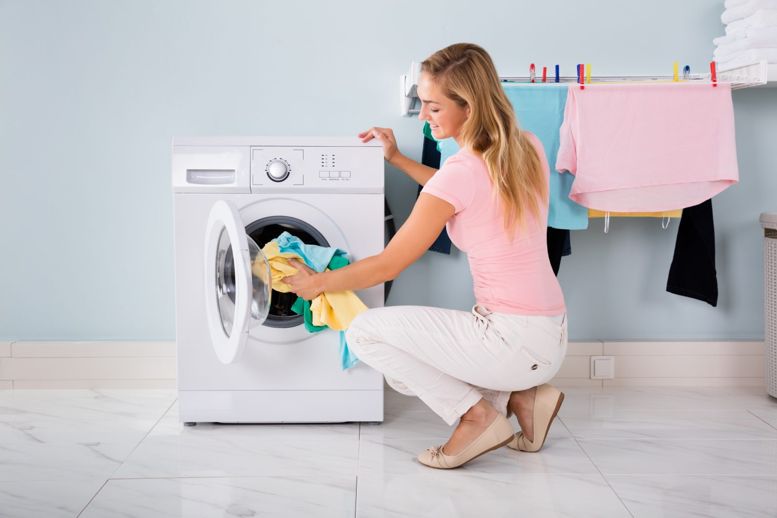 What are the preparations required before putting laundry to washing machine?